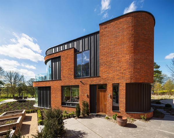 Изящный проект: изогнутый жилой дом в Англии (ФОТО)